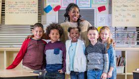 Multi-ethnic elementary students, teacher in classroom