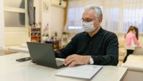 senior man working on laptop at home