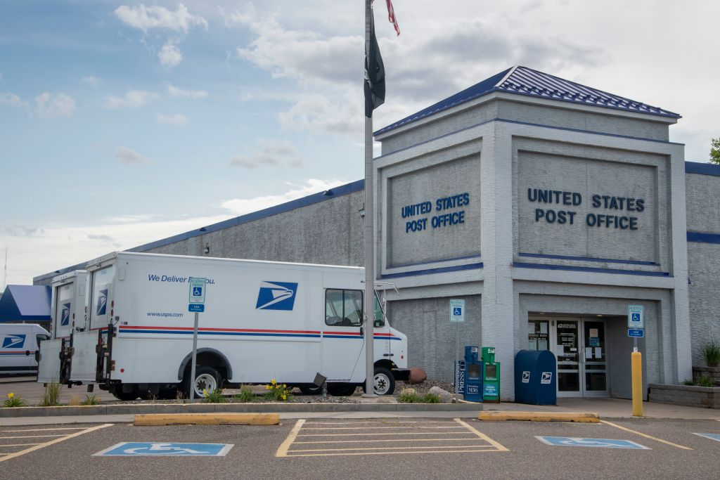 United States Post Office, Mail delivery trucks parked at post office, Roseville, Minnesota.